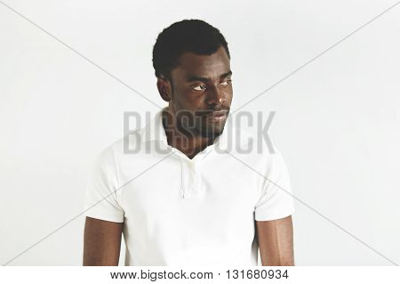 Human Face Expressions And Emotions. Unhappy Young Black Male In Casual Clothes Looking Away With Di