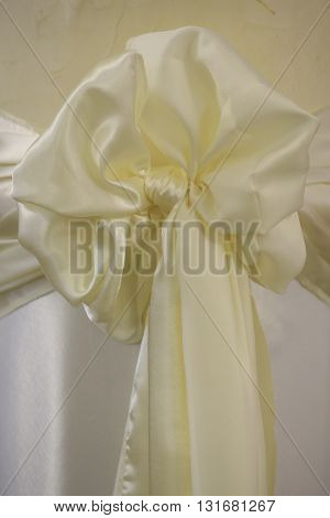 Decorative bow white silk ribbon knot with tail on whiten background