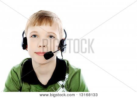 Shot of a boy in headphones with microphone. Isolated over white background.
