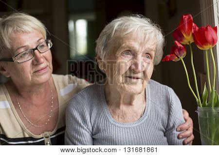 Woman hugging her old mother.