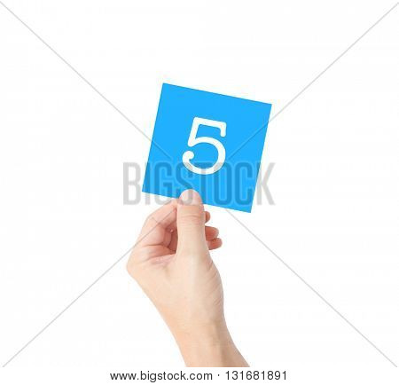 5 written on a card held by a hand