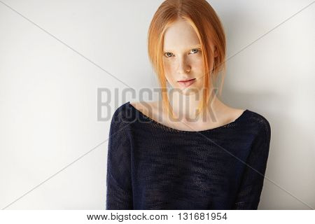 Headshot Of Attractive Student Girl With Red Hair, Blue Eyes And Perfect Healthy Freckled Skin, Wear