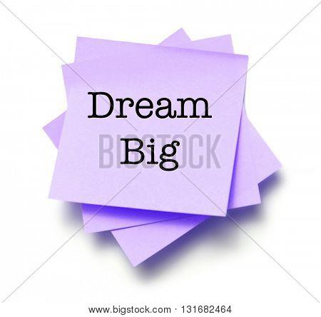Dream big written on a note