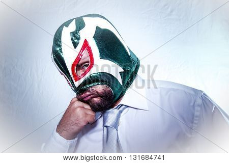 Unhappy, angry businessman with Mexican wrestler mask, expressions of anger and rage