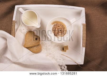 Valentines day greeting card. Cozy morning theme. Cappuccino with cookies on wooden tray