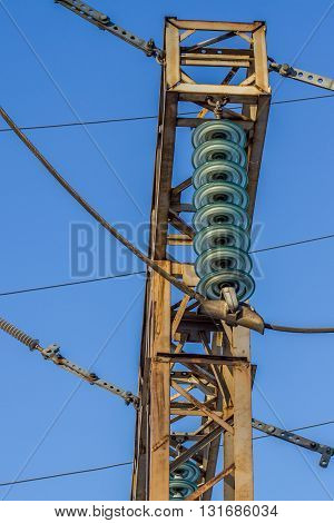 electric insulator on the background of blue sky