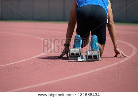 Sprint start in track and field back wiew
