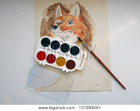 I drew on paper drawing of a fox using watercolor paints and brushes.