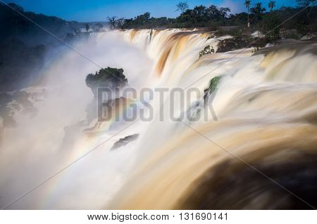 View of the world-famous Iguazu Falls in Argentina with a rainbow