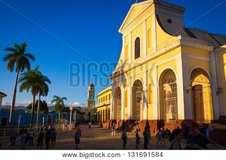 Trinidad, Cuba - December 29, 2015: Main square with colonial cathedral and clock tower
