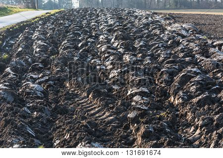 Freshly plowed field with furrows in Germany.