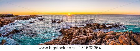 The sun rises over Friendly Beaches in Freycinet national park on Tasmanias east coast