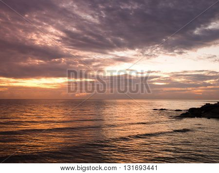 Fantastic view of dark overcast sky over sea. Dramatic orange grey purple sky and cloudy at sunset before rain for background.