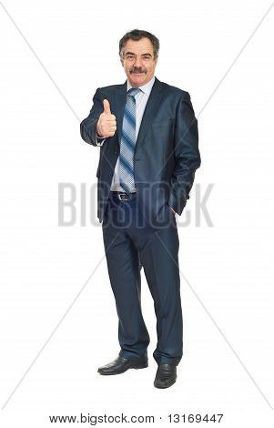 Smiling Senior Business Man Gives Thumbs