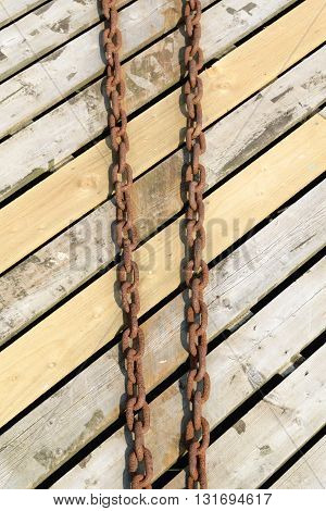 Old metal chains on the wooden floor
