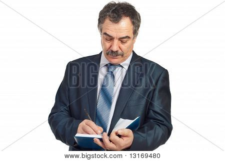 Serious Middle Aged Corporate Man Writing