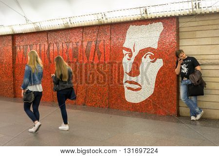 St Petersburg Russia - May 26 2016: Mayakovskaya (Saint Petersburg Metro) opened on November 3 1967 and named after Russian poet Vladimir Mayakovsky. The young man is leaning against the wall.