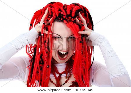 Portrait of a trendy girl with red dreadlocks. Shot in a studio.