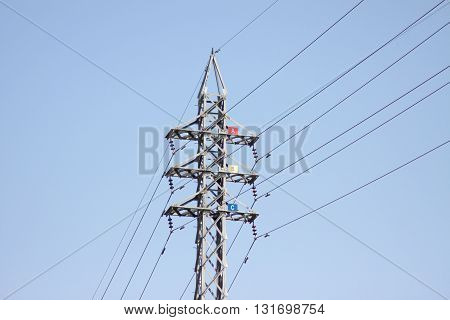 High voltage electrical steel tower on the road