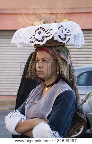 QUARTU S.E., ITALY - September 15, 2012: Parade of the 2012 Wine Festival - Sardinia - woman in Sardinian costume wears on his head a basket with bread