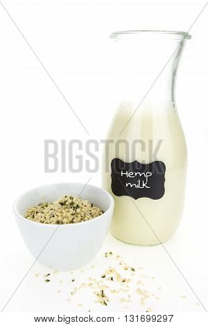 Hemp Milk And Hemp Hearts In Bowl,  On White Background