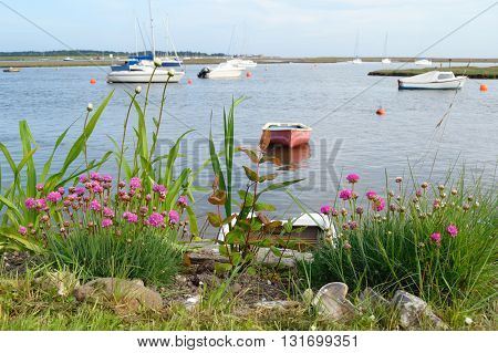 Sailing boats in Wells-next-the-sea harbor Norfolk England