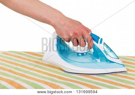 Steam iron in a female hand, ironing towels on a white background.