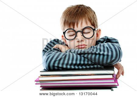 Educational theme: boy teenager sleeping on his books. Isolated over white background.