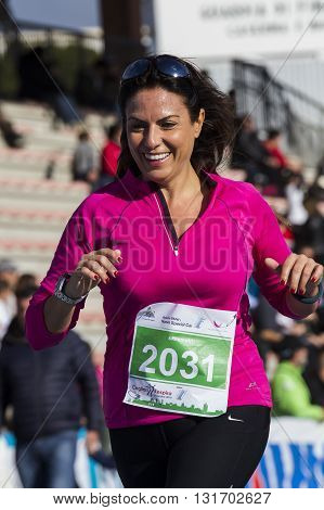 CAGLIARI, ITALY - December 7, 2014: 7 ^ Half Marathon - Memorial Delio Serra - portrait of a beautiful girl at the end of the race