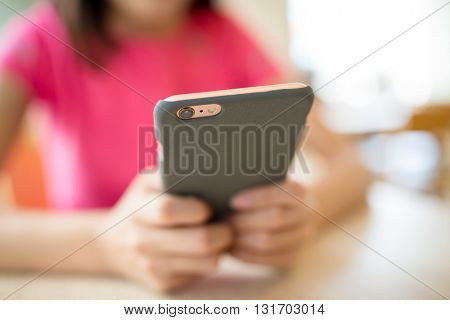 Woman use of mobile phone at cafe