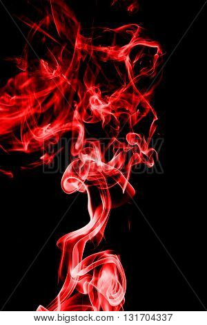 Abstract red smoke on black background from the incense sticks