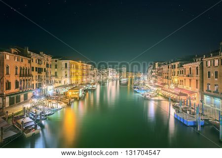 View to the grand canal, boats and buildings from the bridge in Venice, Italy
