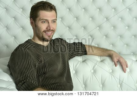 young man relaxing  on sofa at home