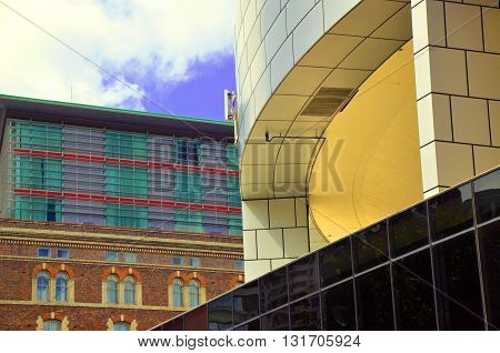 Meeting of architectural styles- contrasting modern and old buildings