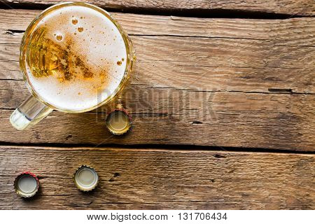 Light Beer Mug On The Wooden Background