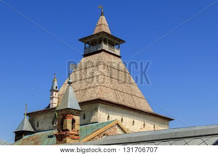 ROSTOV RUSSIA - JUNE 3 2013: Rostov Kremlin. It is a well-preserved Russian fortification - castle tower with a wooden roof and a gallery guard.
