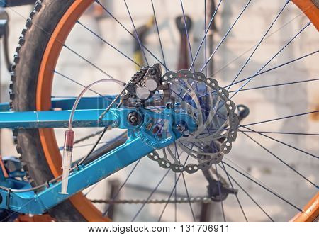 Bleeding the disk brakes on a bicycle.