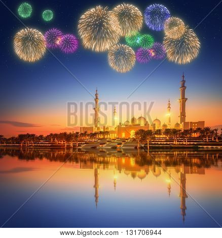 Beautiful fireworks under Sheikh Zayed Grand Mosque at dusk, Abu-Dhabi, UAE