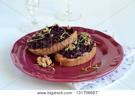 Sandwich with beetroot and walnuts, selective focus