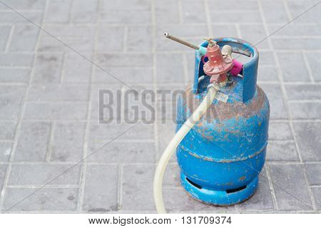Gas tank cylinder balloon with valve and tube on the ground