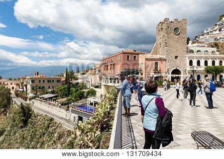 TAORMINA ITALY - MAY 21: Tourists at the main plaza of Taormina on May 21 2016 at the island Sicily Italy