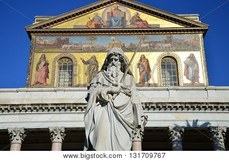 marble statue of Saint Paul in front of The Papal Basilica of Saint Paul outside the Walls