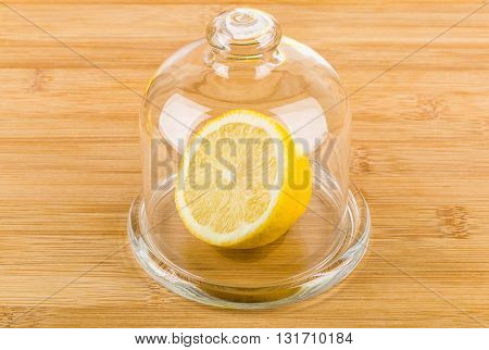 Half Lemon In Transparent Saucer With Lid