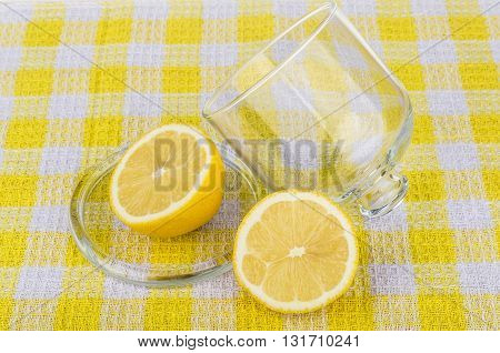 Transparent Saucer With Lid And Lemon On Tablecloth