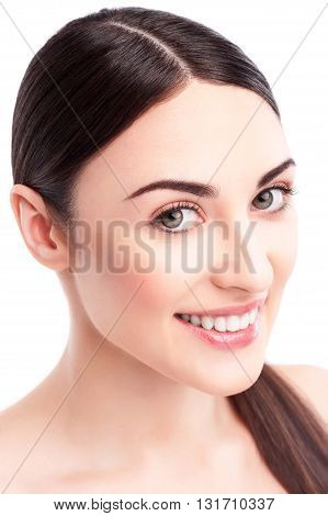 Portrait of cheerful healthy girl caring of her skin. She is standing and smiling. Isolated