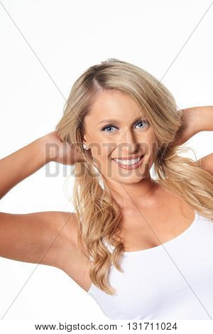 Portrait of playful beautiful blonde model isolated on white