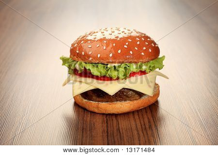 Appetizing cheeseburger. Isolated over white background.