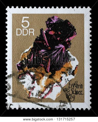 ZAGREB, CROATIA - SEPTEMBER 06: A stamp printed in GDR shows Erythrite from the series Minerals, circa 1969, on September 06, 2014, Zagreb, Croatia
