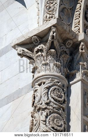 PISA, ITALY - JUNE 06, 2015: Facade decorated column of Cathedral in Pisa, Italy. Unesco World Heritage Site, on June 06, 2015