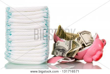 A stack of diapers, broken piggy bank and money isolated on white background.
